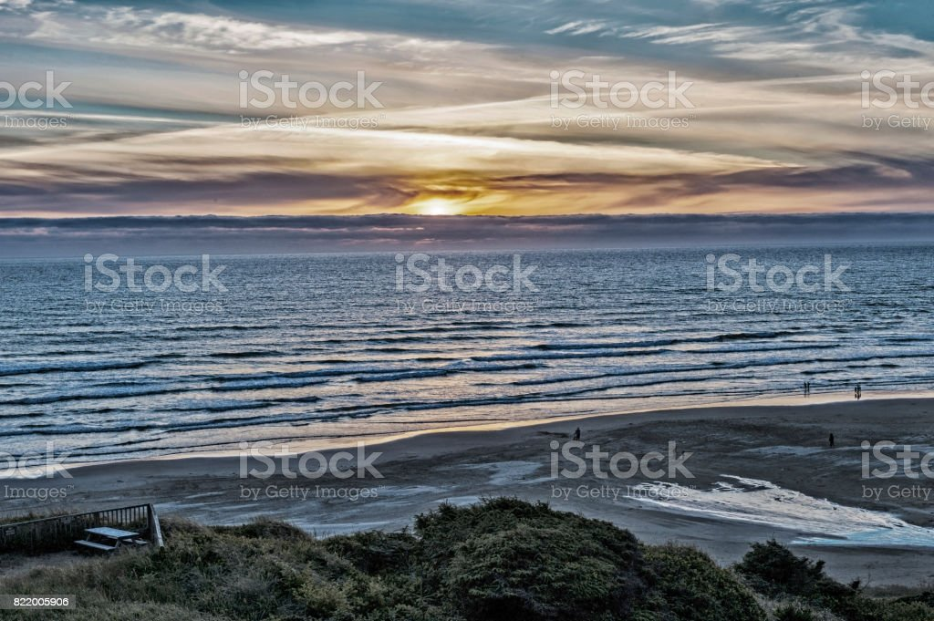 Sunset at Newport Oregon with People on Beach stock photo