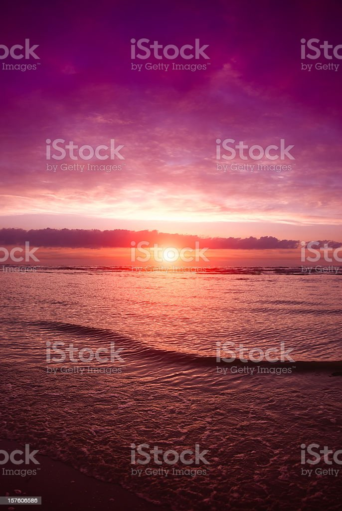 Sunset at North Sea beach with moody sky stock photo