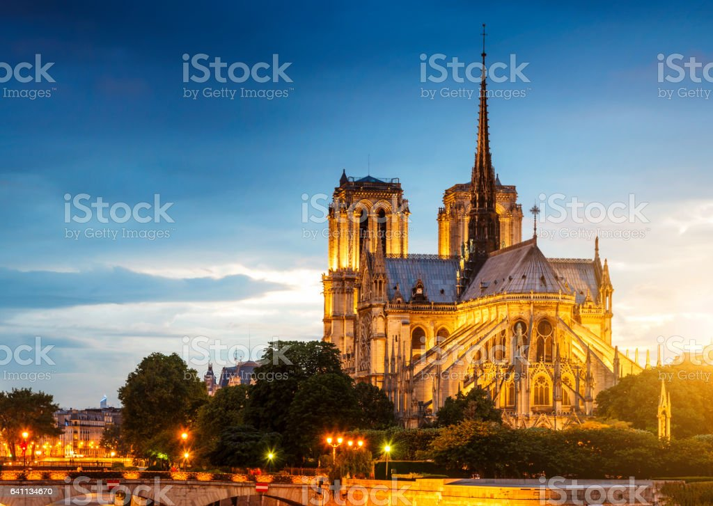 Sunset at Notre dame on Seine river stock photo