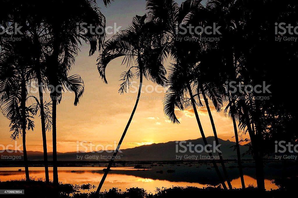 Sunset at Phayow lake, north of Thailand. stock photo