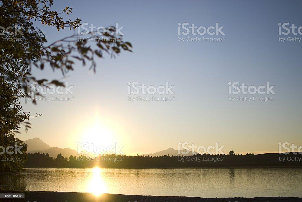 """Sunset at """"Bannwaldsee"""" Germany stock photo"""