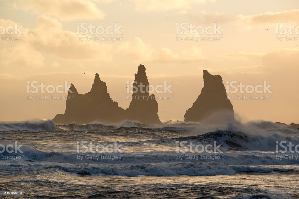 Sunset at Reynisdrangar cliffs, Black sand beach in Vik, Iceland. stock photo