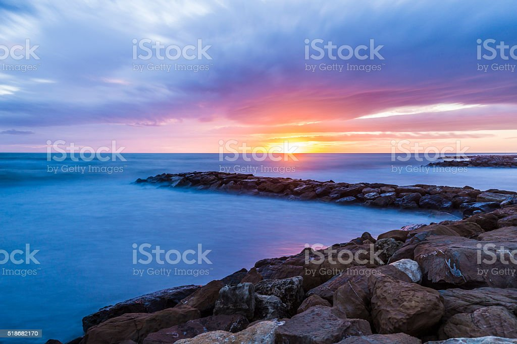 Sunset at sea in Italy stock photo