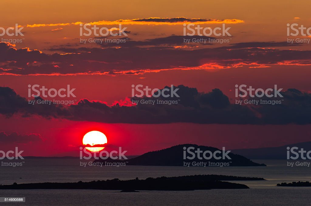 Sunset at sea, with small greek islands in background, Sithonia stock photo