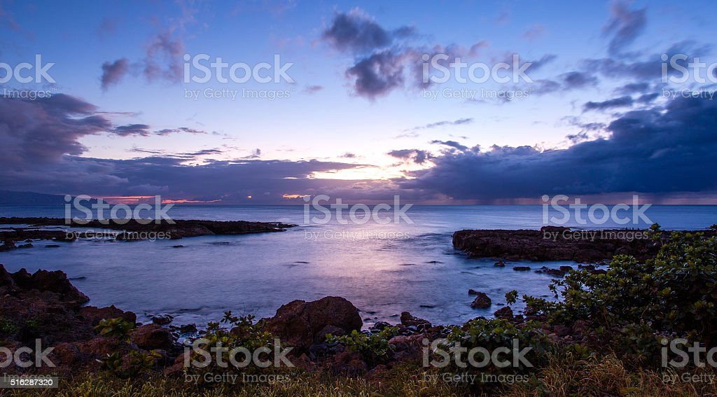 Sunset at Shark's Cove, North Shore, HI stock photo