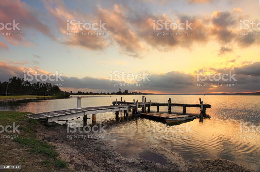 Sunset at Squids Ink Jetty, Belmont on Lake Macquarie. stock photo