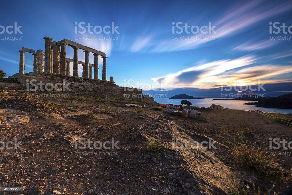 Sunset at Temple of Poseidon in long exposure stock photo