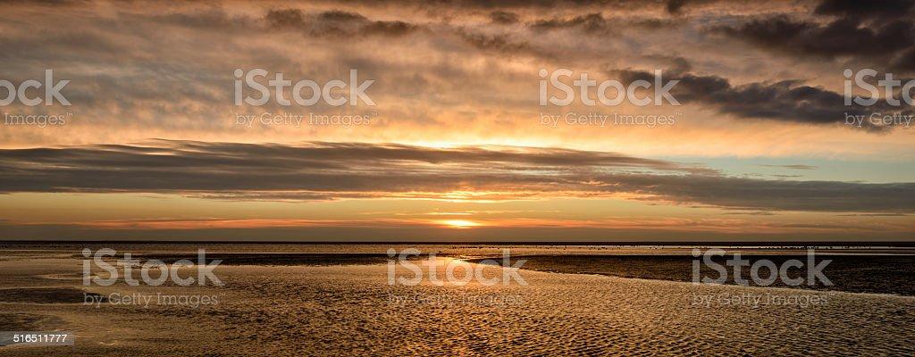 Sunset at the beach panorama stock photo