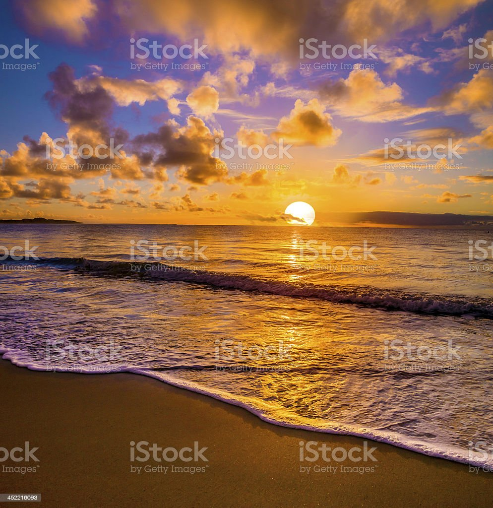 Sunset at the beach stock photo