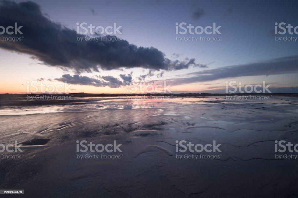 Sunset at the beach stock photo