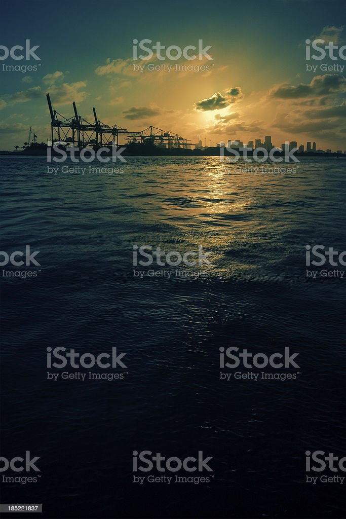 sunset at the industrial port of miami stock photo