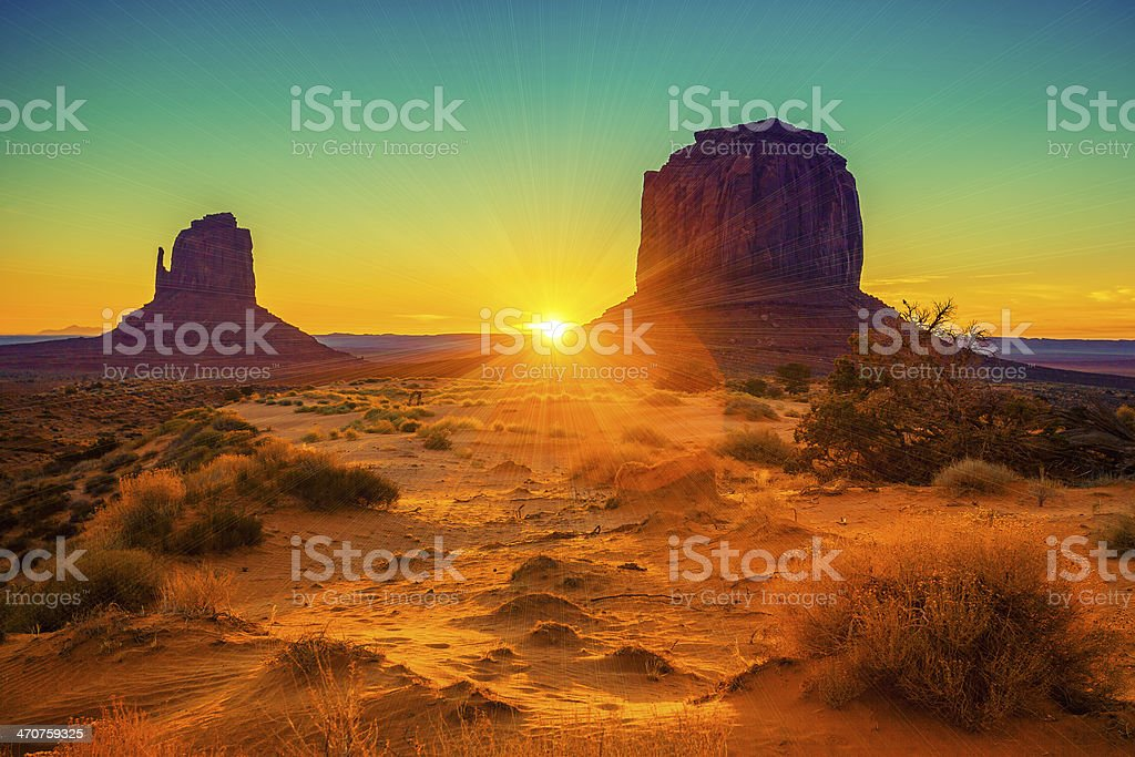 Sunset at the sisters in Monument Valley stock photo