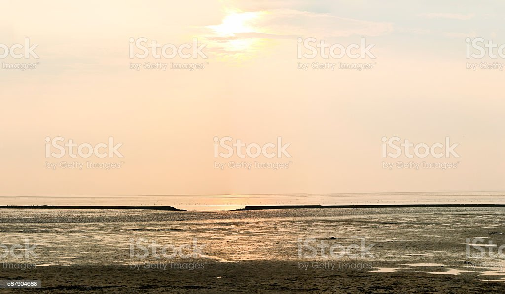 Sunset at the Wadden Sea at Low Tide stock photo