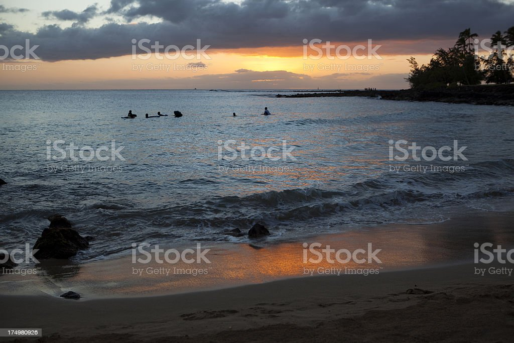Sunset at Tropical Paradise Poipu Beach with Surfers royalty-free stock photo