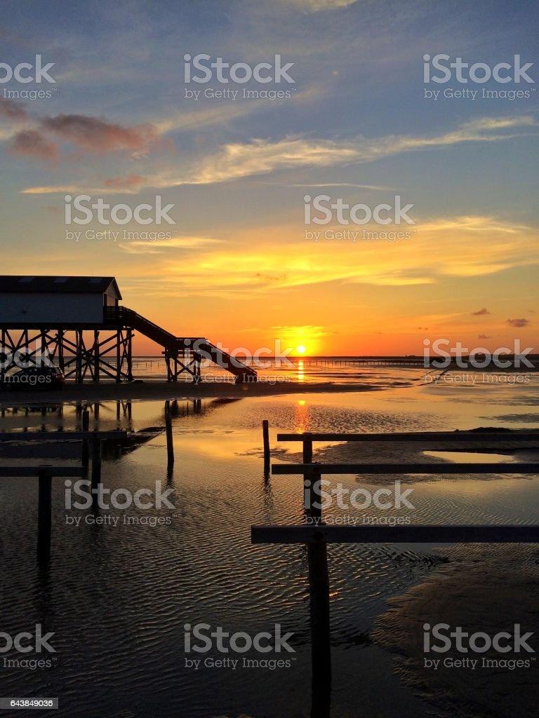 Sunset at wadden sea stock photo