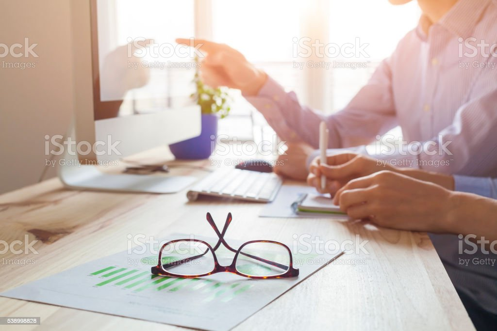 Sunset atmosphere in co-working office, business meeting stock photo
