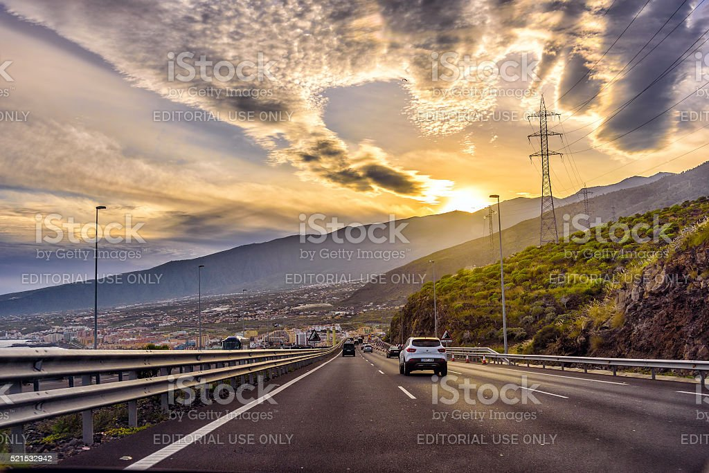 Sunset auto road with cars among hills on Tenerife island stock photo