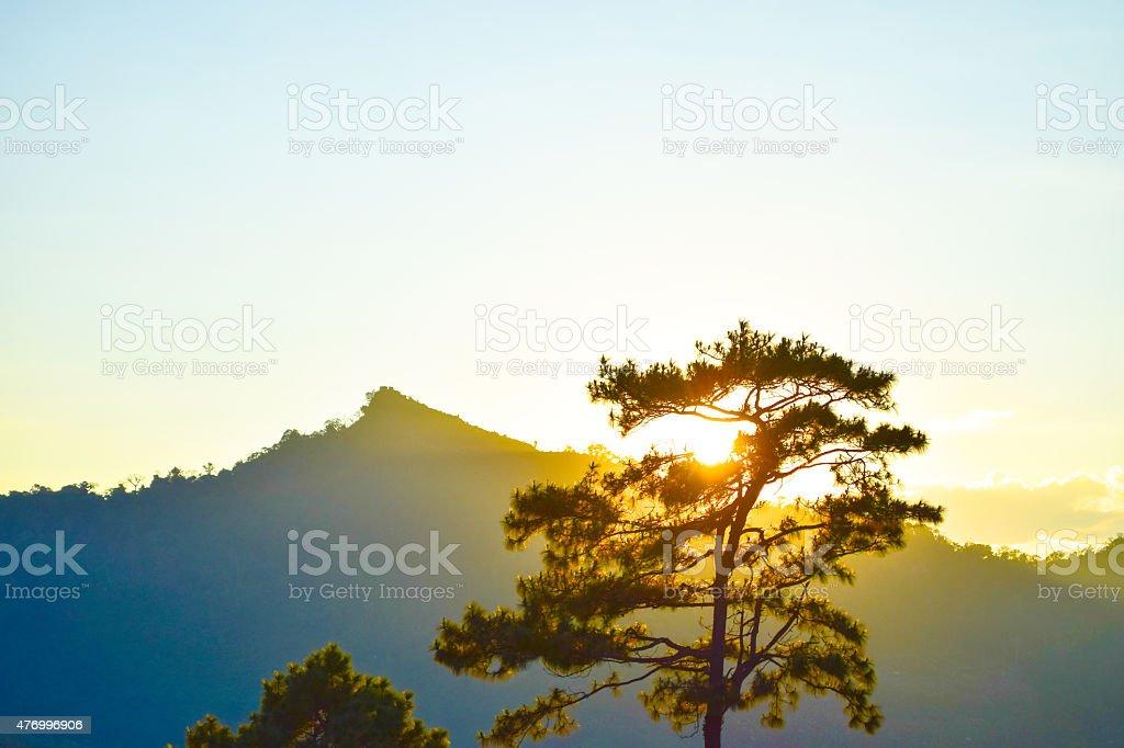sunset background behind mountain stock photo