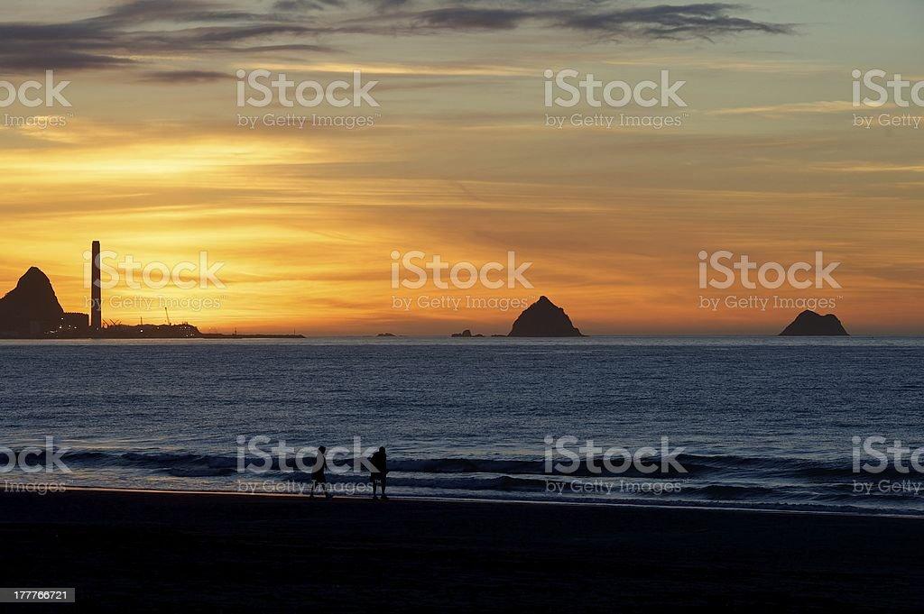 Sunset beach New Plymouth stock photo