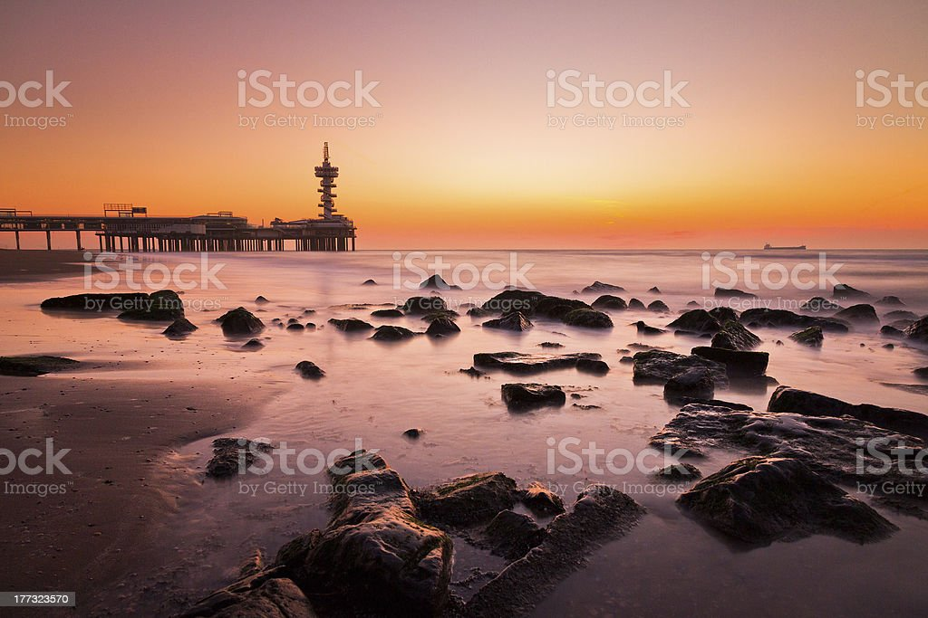 Sunset beach rocks stock photo