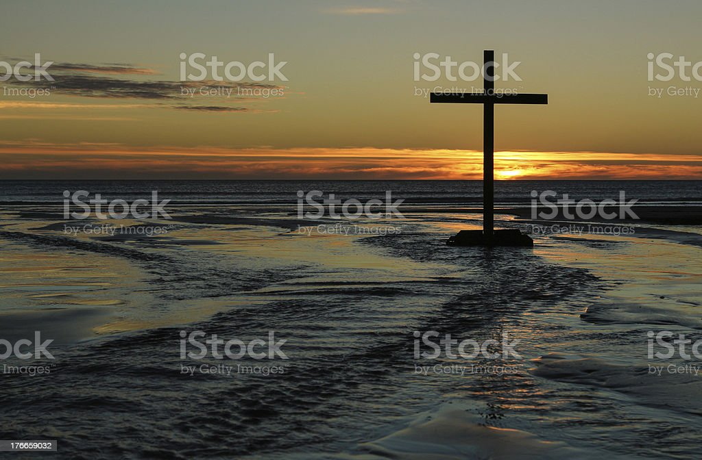 Sunset Beach Waters Cross stock photo