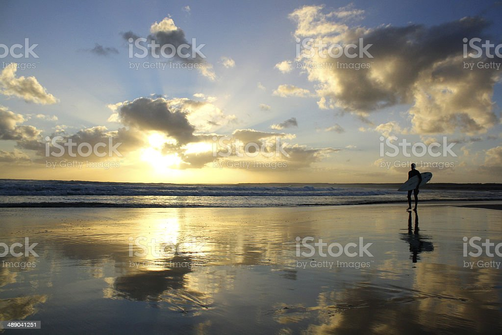 Sunset beach with Surfer stock photo