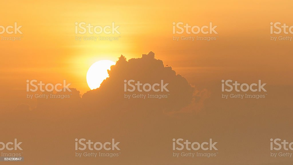Sunset behide the clouds royalty-free stock photo