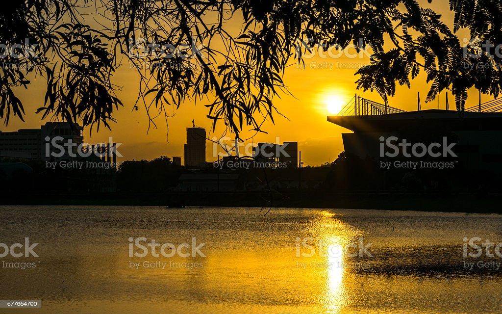 Sunset behind a building. stock photo
