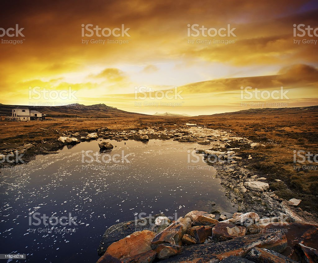 Sunset behind a river in a valley stock photo