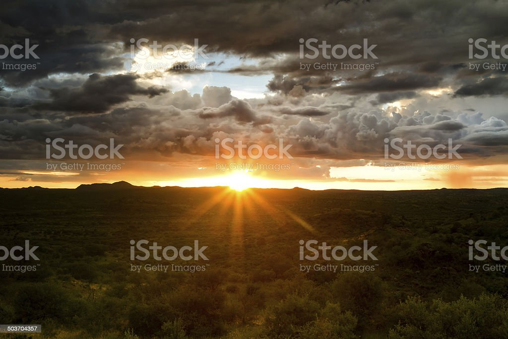 Sunset behind a thunderstorm stock photo