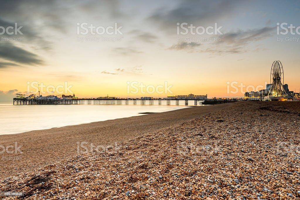 Sunset behind Brighton beach landmarks stock photo