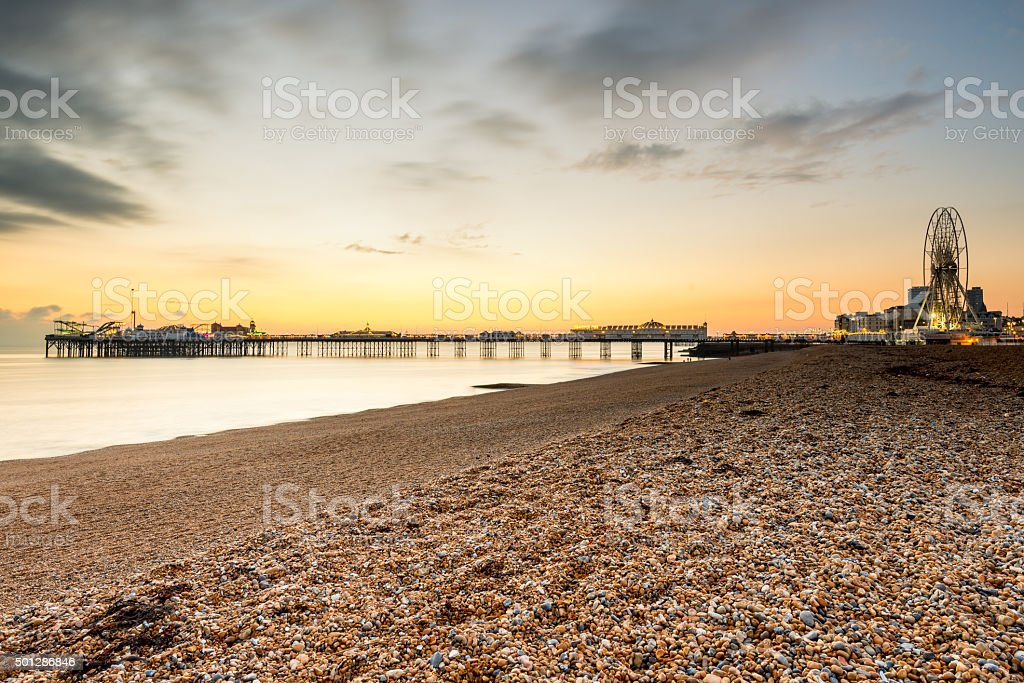Sunset behind Brighton beach landmarks stock photo