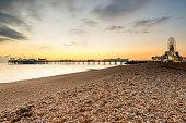 Sunset behind Brighton beach landmarks