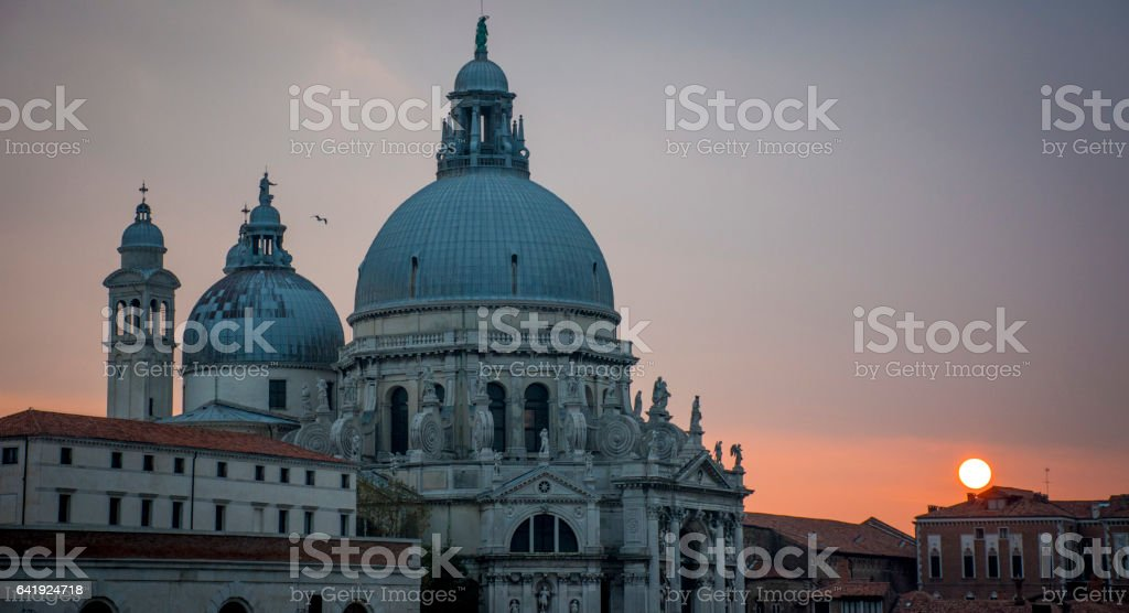Sunset behind  Cathedral of Santa maria Della Salute in Venice stock photo