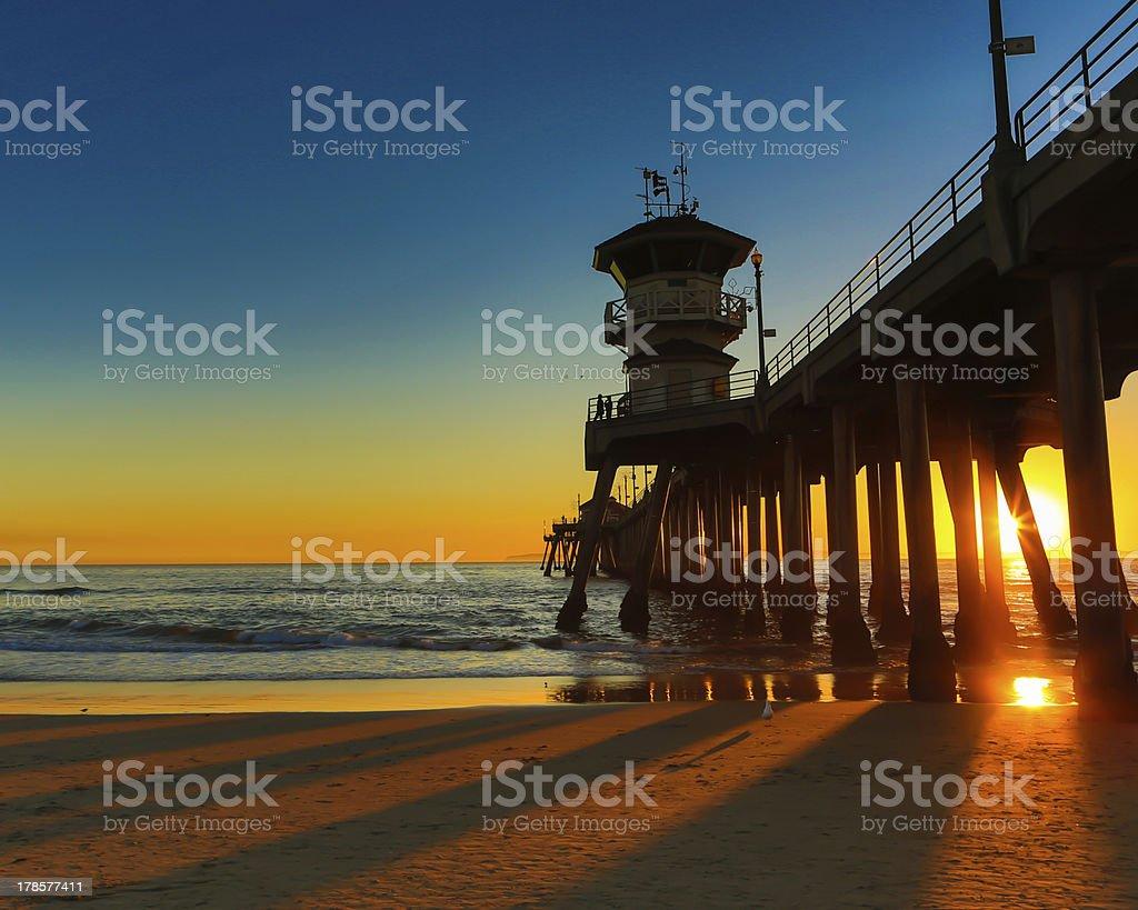 Sunset behind Huntington Beach Pier stock photo