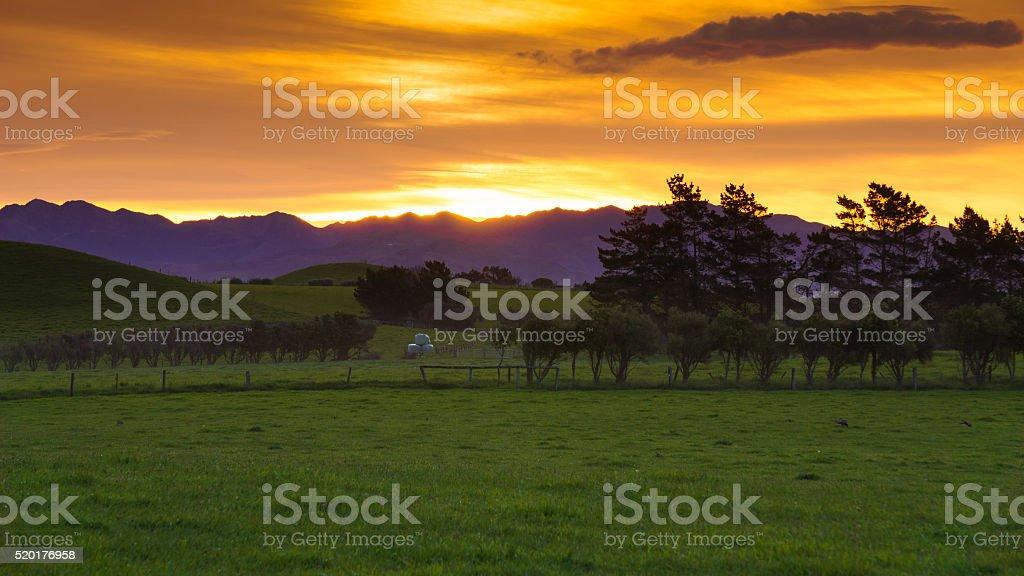 Sunset behind Kaikoura mountain range stock photo