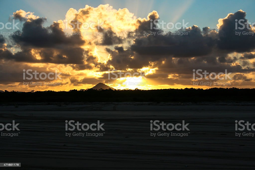 Sunset behind mountain stock photo