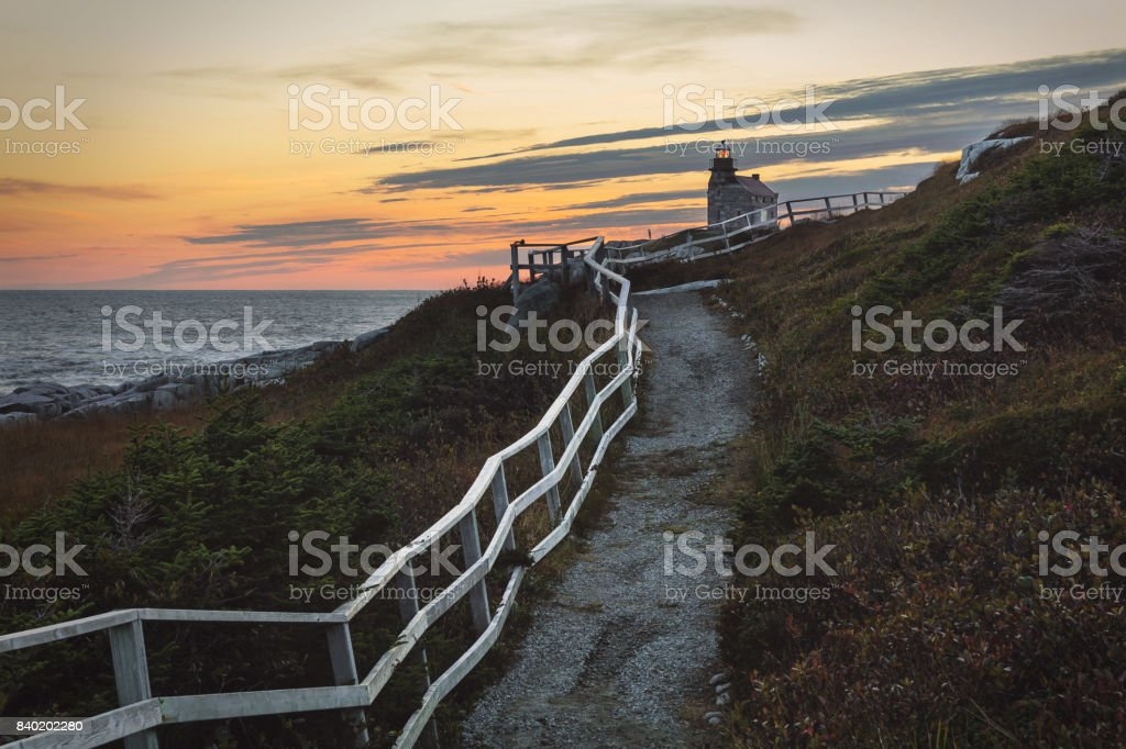 Sunset behind rose blanche lighthouse stock photo