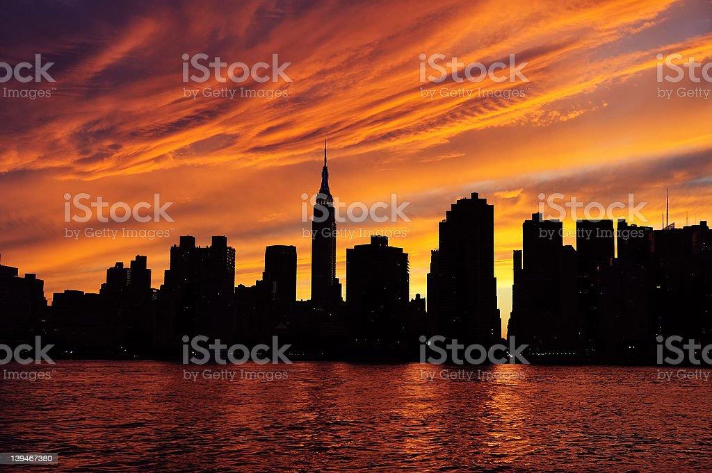 Sunset behind the Manhattan skyline in New York stock photo