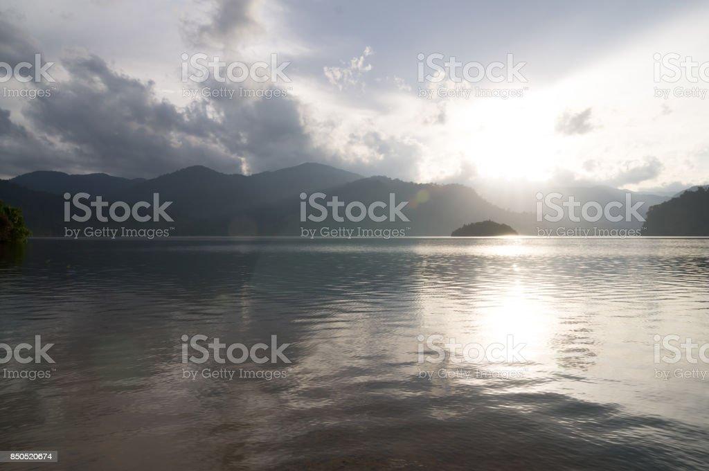 Sunset behind the mountain stock photo