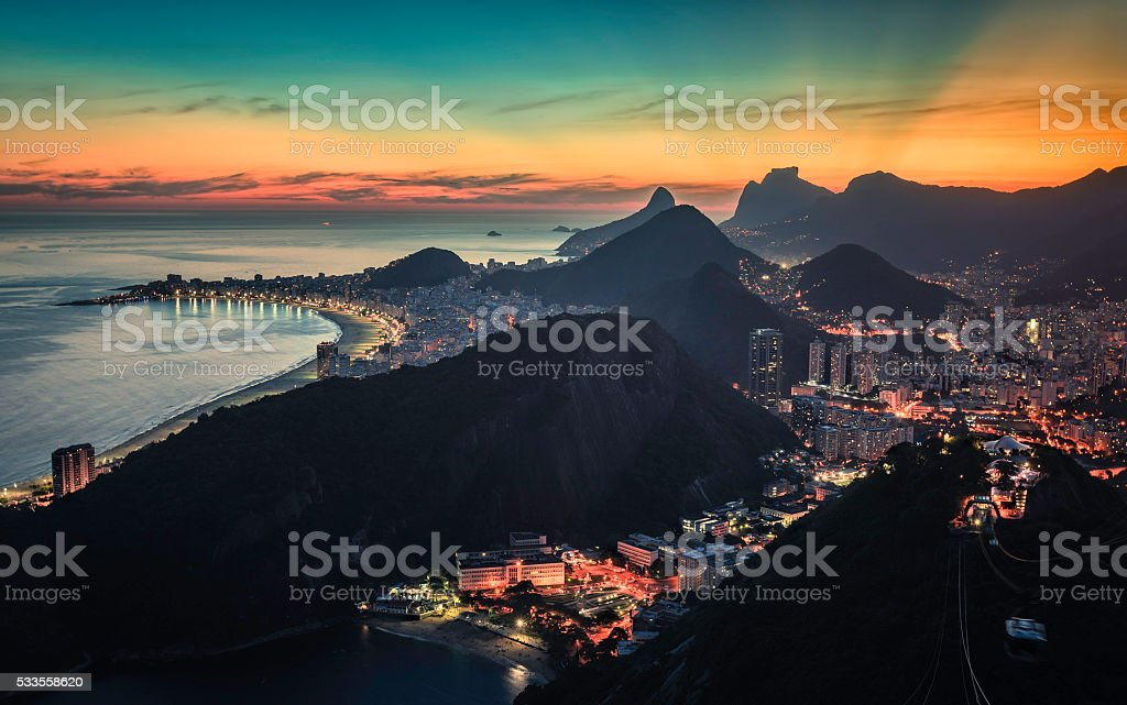 Sunset behind the mountains with iluminated Rio de Janeiro stock photo