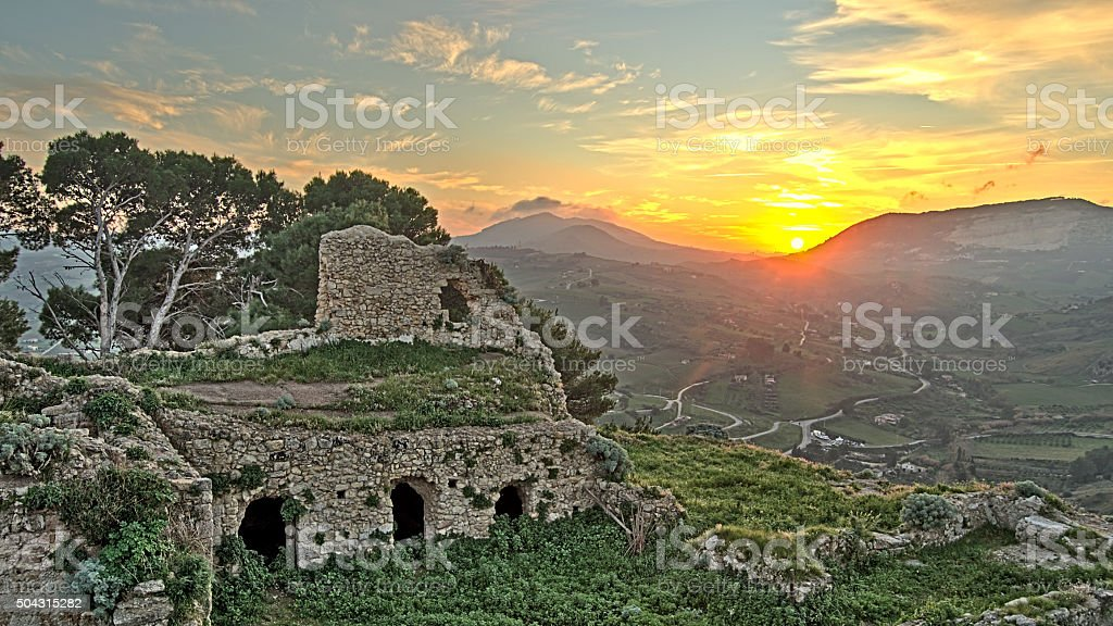 Sunset behind the ruins stock photo