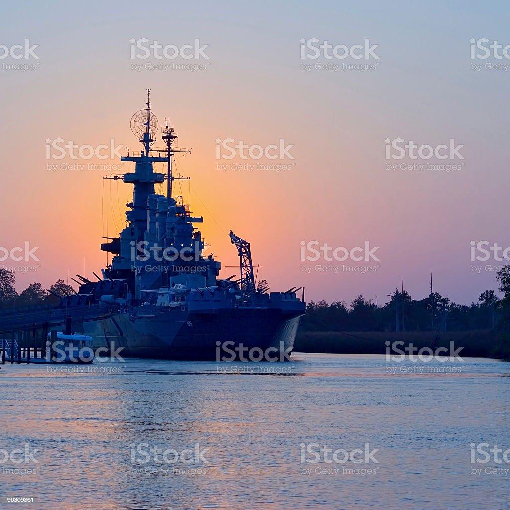 Sunset behind USS North Carolina stock photo