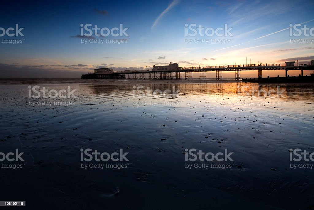 Sunset Behind Worthing's Victorian Pier and Ocean royalty-free stock photo
