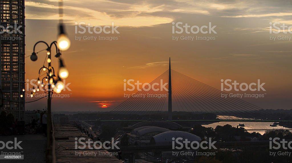 sunset belgrade bridge stock photo