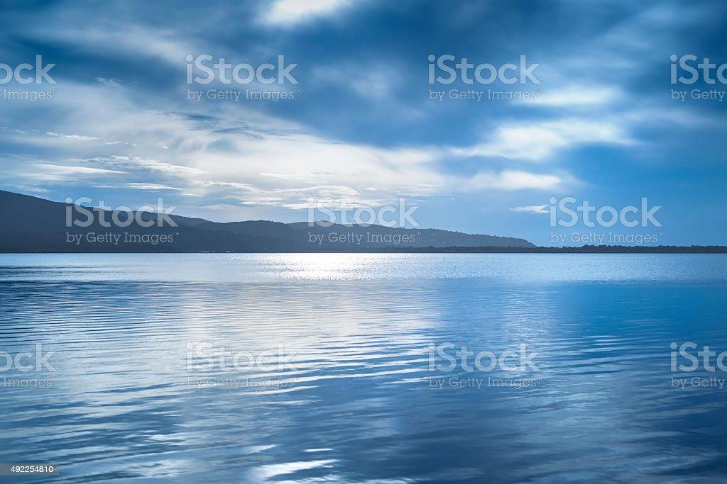 Sunset blue landscape. Orbetello lagoon, Argentario, Italy. stock photo