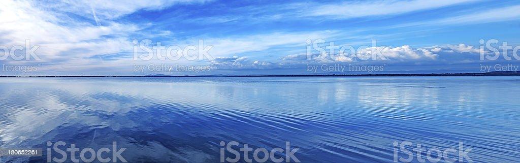 Sunset blue panoramic landscape. Orbetello lagoon, Argentario, Italy. stock photo