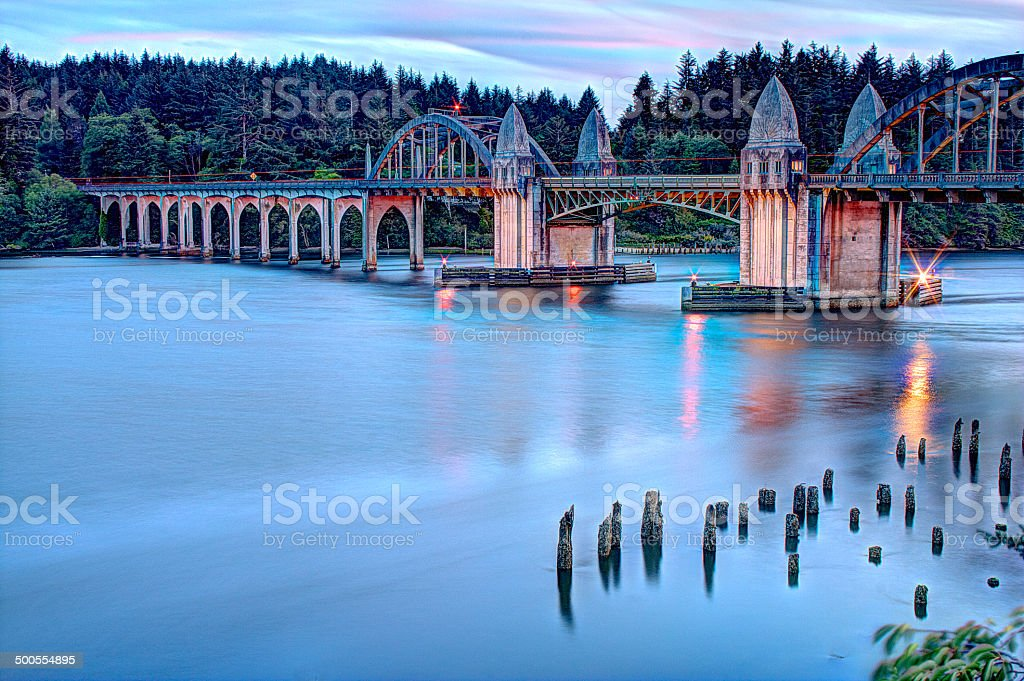Sunset Blue Reflections Historic Siuslaw River Bridge Florence Oregon HDR stock photo