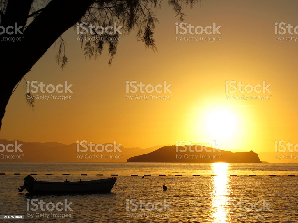 Sunset boat stock photo