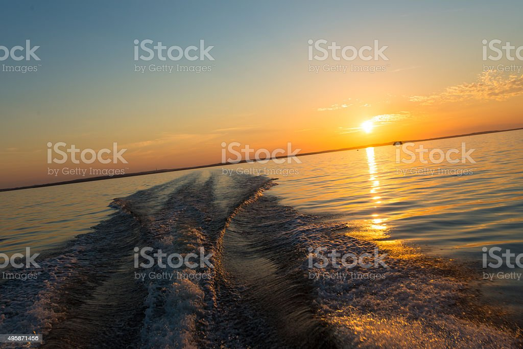Sunset boat ride on calm seas stock photo